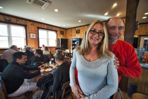 Faith like a Mustard Seed Farm is a working farm that also serve's brunch on weekends that focuses on fresh foods, many of which are raised on site. Here owners Patricia and Karl Glaeser pose for a photo in the dining room. [Douglas Graham/Loudoun Now]