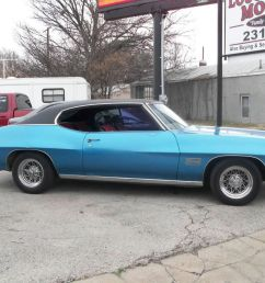 1970 pontiac lemans sport bright blue black red cloth interior v 8 350 auto two door hardtop was an a c car am fm  [ 1280 x 960 Pixel ]