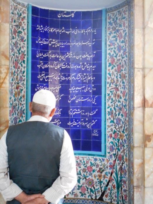 Man reading at shrine