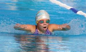 Louisburg's Sabra Brueggen won four events last Saturday.