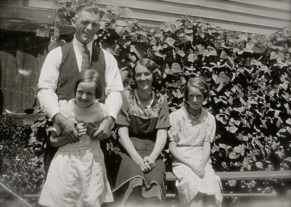 My grandmother and grandfather, and two unknown girls, presumably sisters.