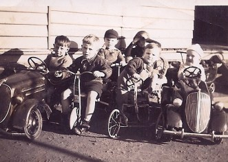 zz The kids with their cars - Dad is little fella climbing into his, second from right - Version 2