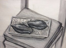 aubergines on a patterned plate in compressed charcoal