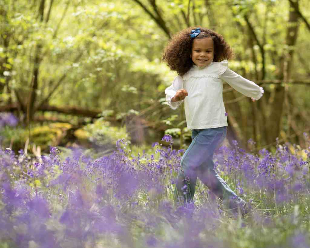 Dancing in the bluebells in Bluebell photoshoot in Sussex