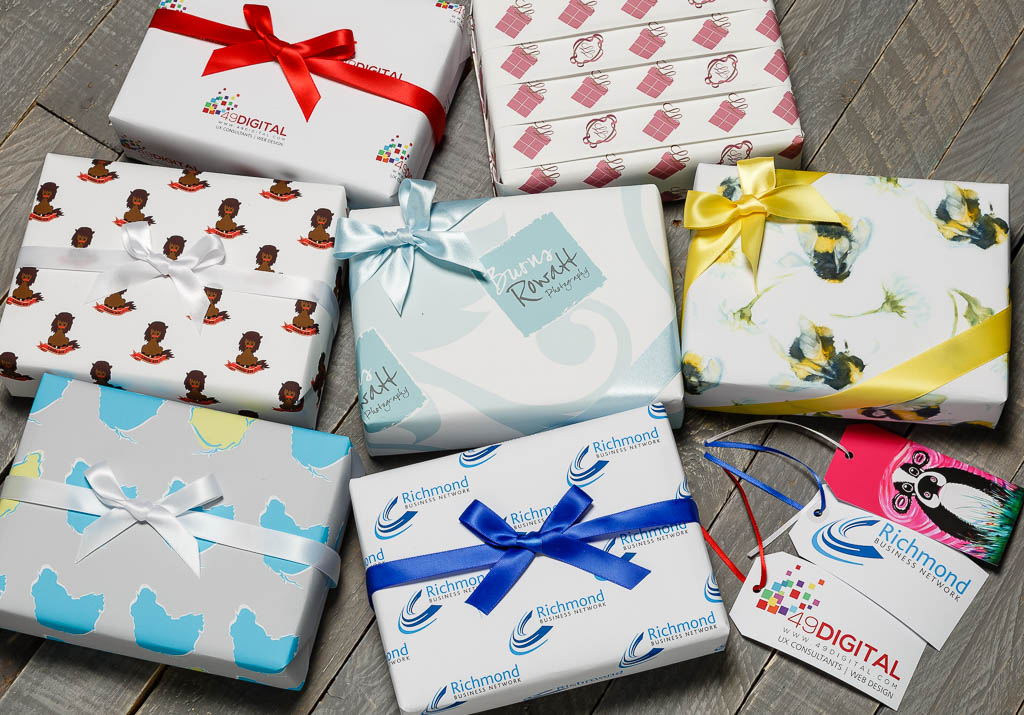 Branded packaging with coordinating ribbons and luggage tags