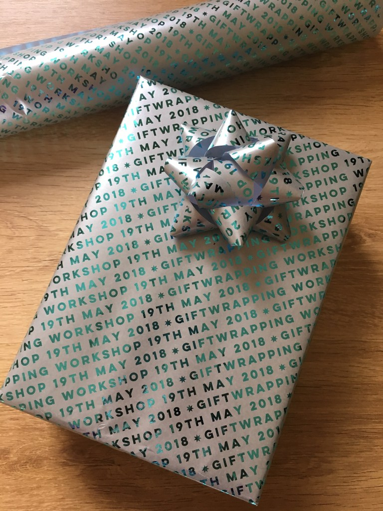 Pretty Gifted foil giftwrap with giftwrapping workshop 19th May printed on it