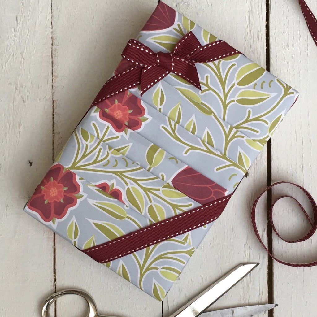 Japanese pleated parcel with burgundy corner bow ribbon