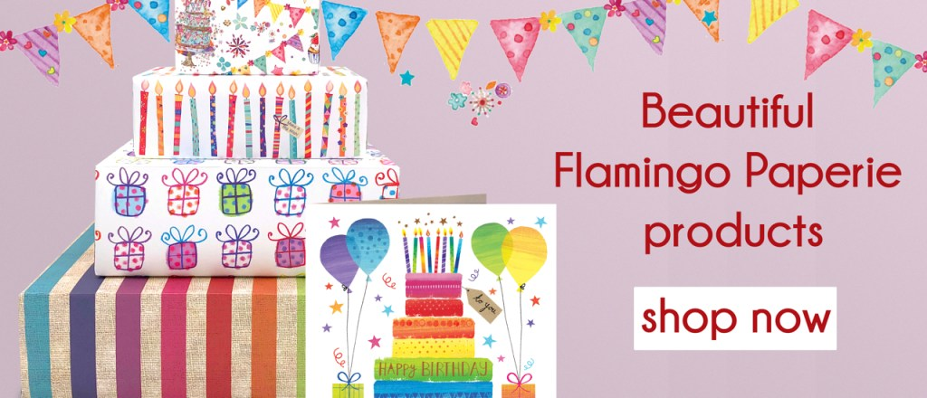 Image of stacked parcels and a greetings card with a brightly coloured cake and candles