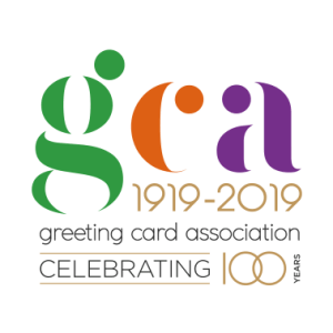 The initials GCA in green, orange and purple