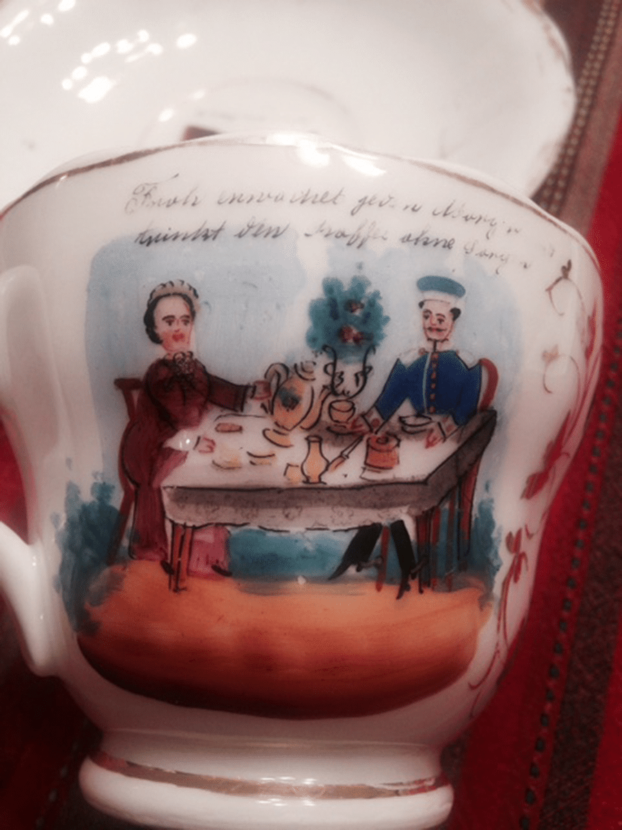 rare vintage baby cup 1882 with couple having tea