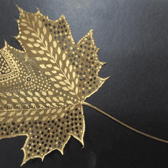 gold and black acrylic on autumn leaf