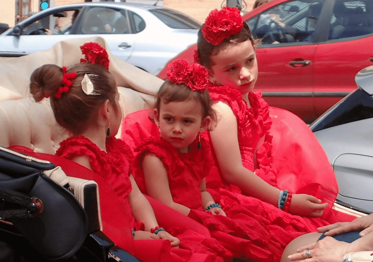 Little girls in carriage in Seville going to casetas in Real de la Feria