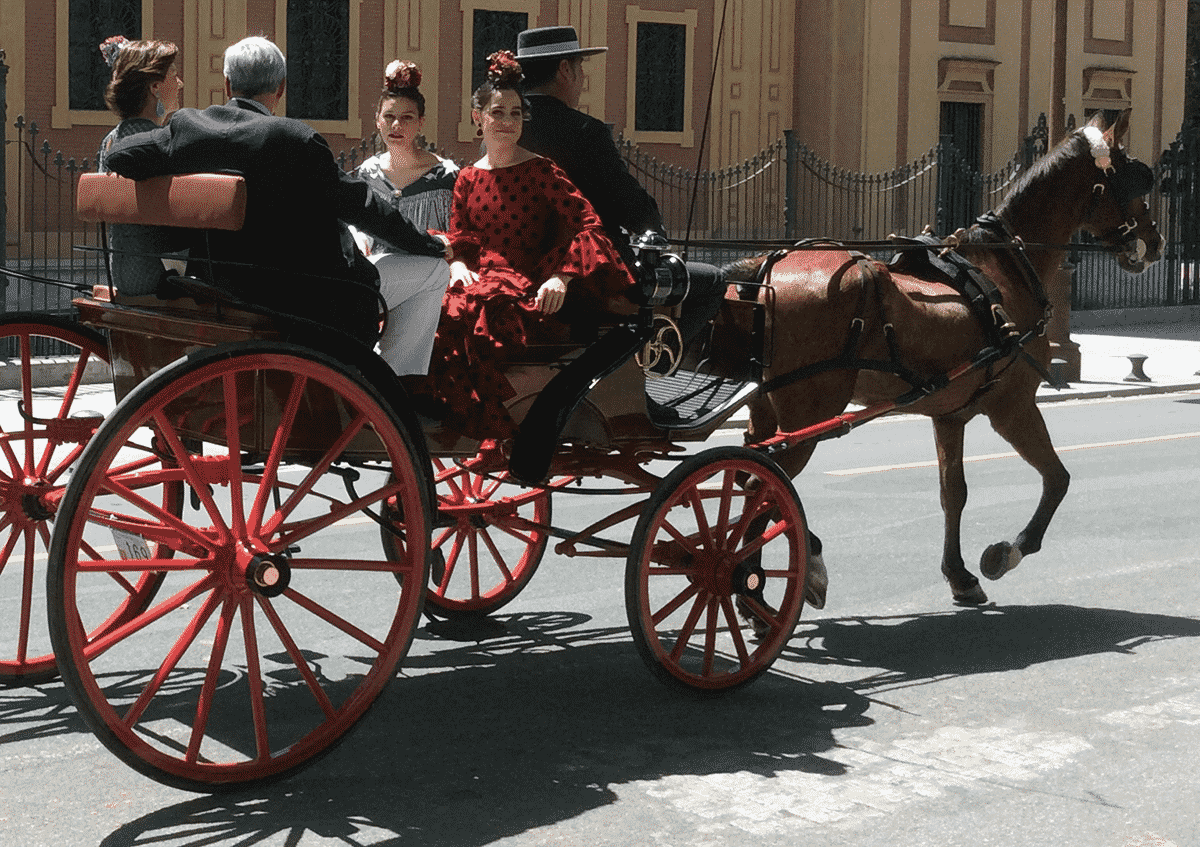 Seville family in horse drawn carriage on their way to the Feria.