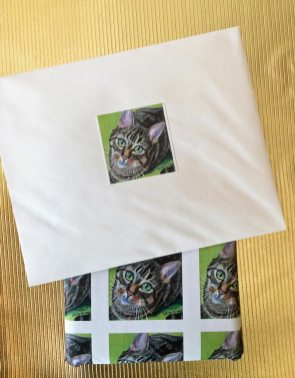 stickers and wrapping paper with unique cat theme