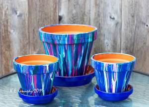Acrylic pour over clay pots by Kris Kennedy
