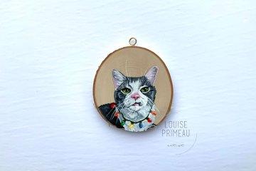 Tony, tangled in Christmas lights, wood slice ornament
