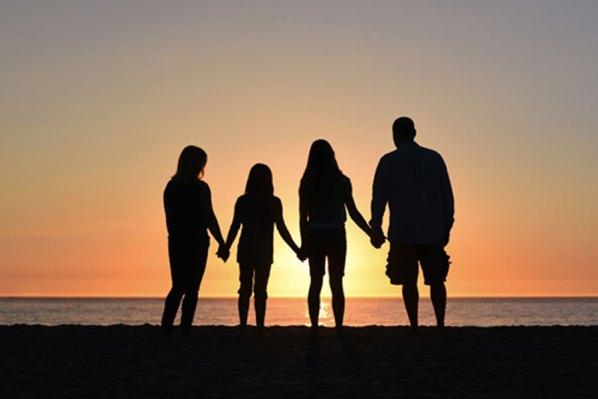 Family at sunset - copyright free photo.