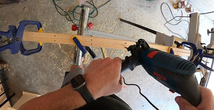 Drilling the countersinks on the 3' boards on the top and bottom of the  Halloween DIY faux wrought iron fence.