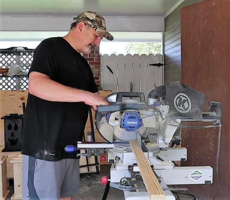 """Cutting the 1 1/2"""" boards for the upper and lower portion of the Halloween DIY faux wrought iron fence."""