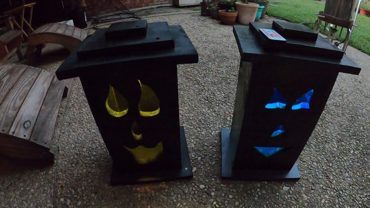 Completed Halloween DIY Jack-o-Lantern Light-up boxes ready to be staged in the front yard as part of the Halloween decorations.