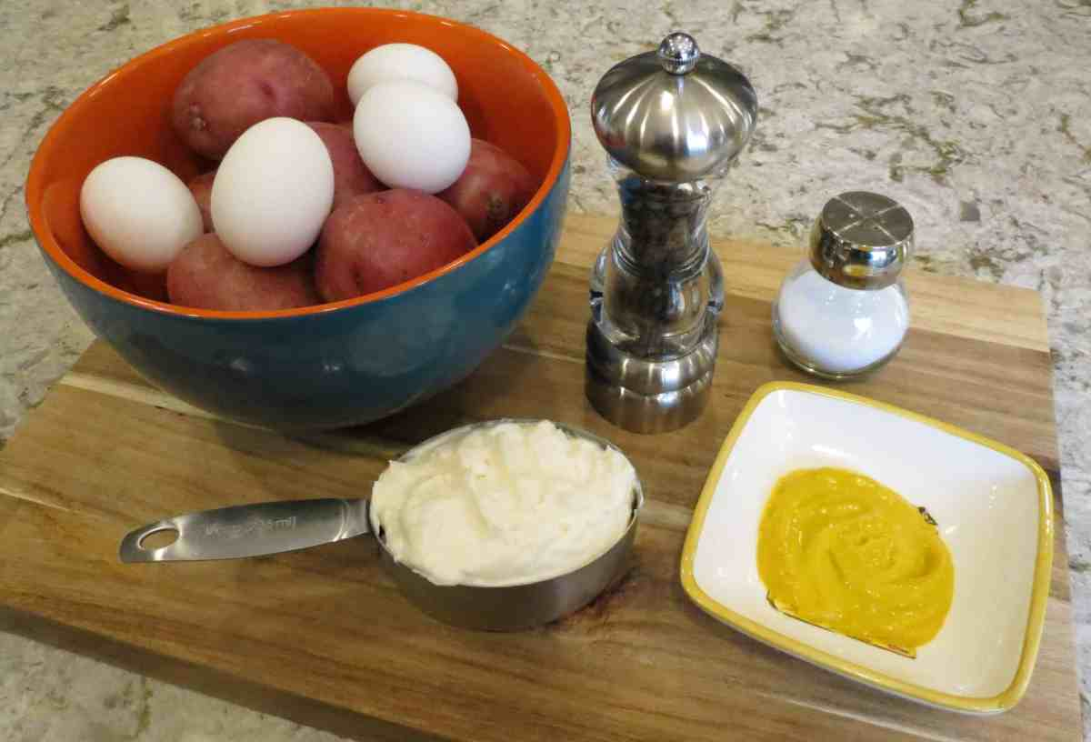 Ingredients for Plain Potato Salad on a cutting board.