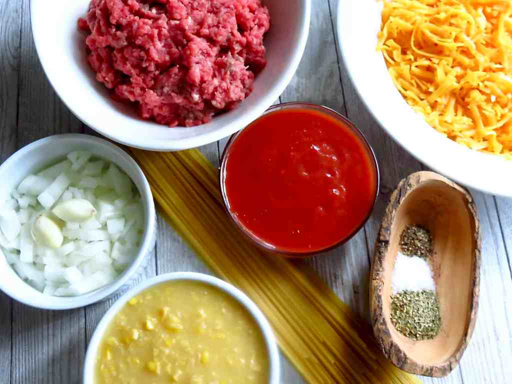 Ingredients of ground beef, cheese, and cream corn for More Casserole, Cast Iron One-Pot Meal.