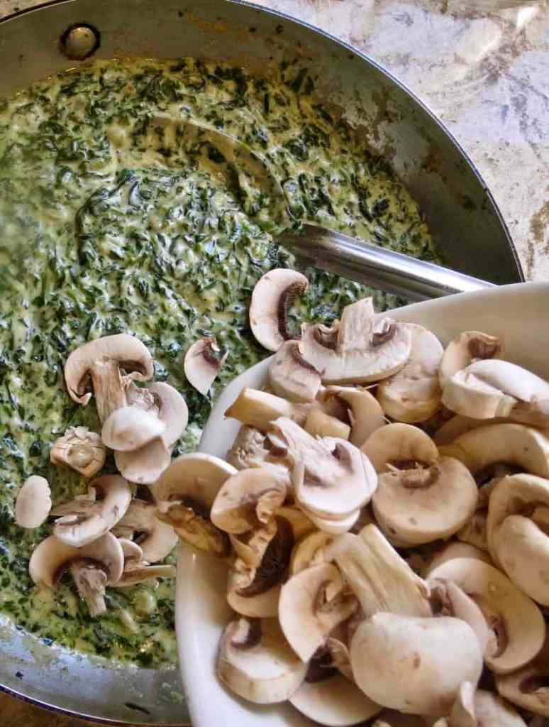 Fresh mushrooms added to saucepan of Creamed Spinach With Mushrooms.