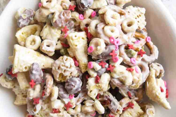 A white bowl full of Valentine Candy Crunch.