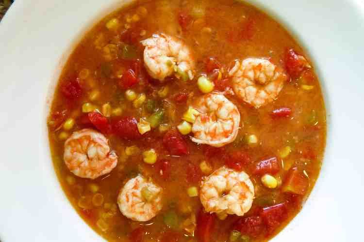 A white bowl filled with Shrimp And Corn Soup.