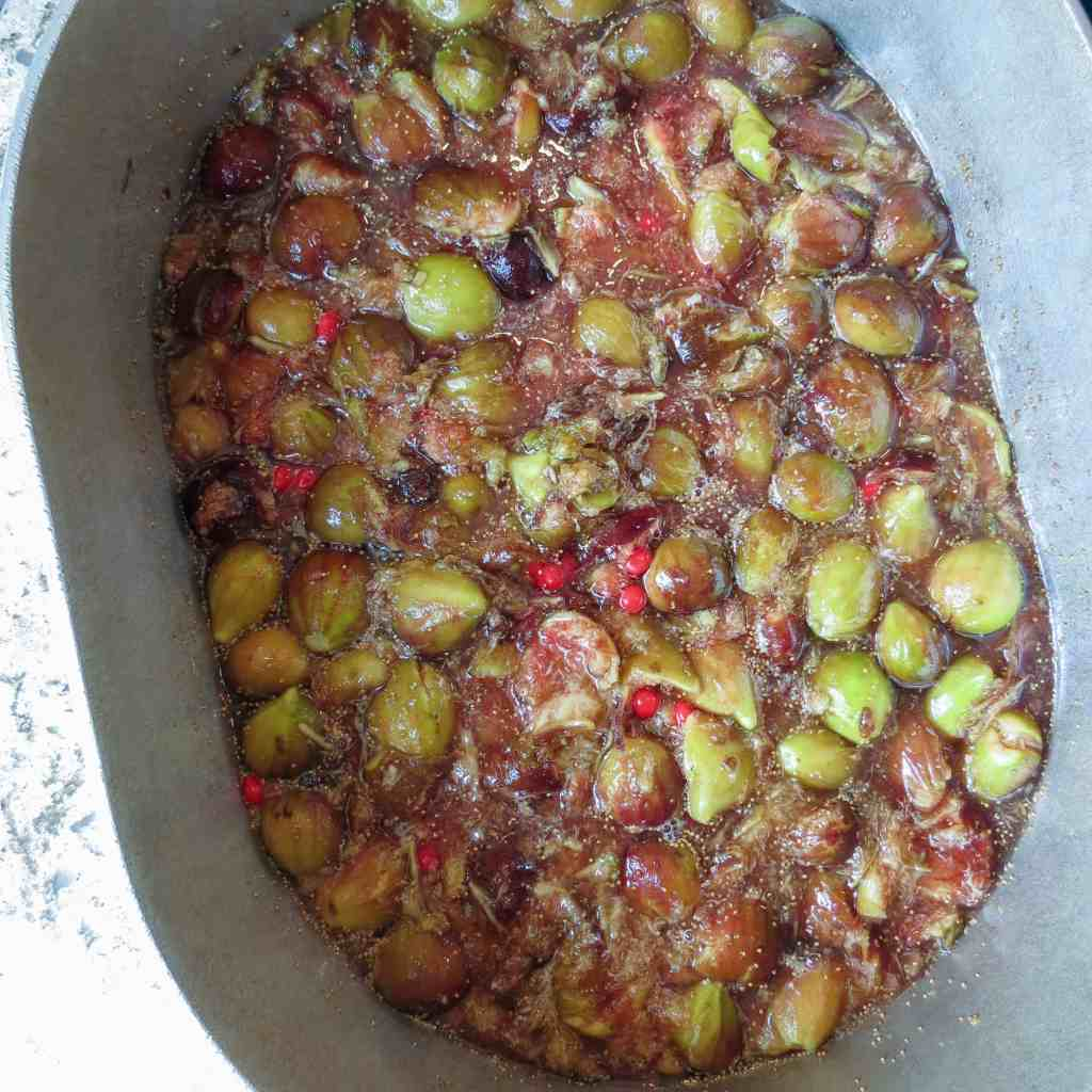 A large pot of crushed figs cooking with red hot candies.
