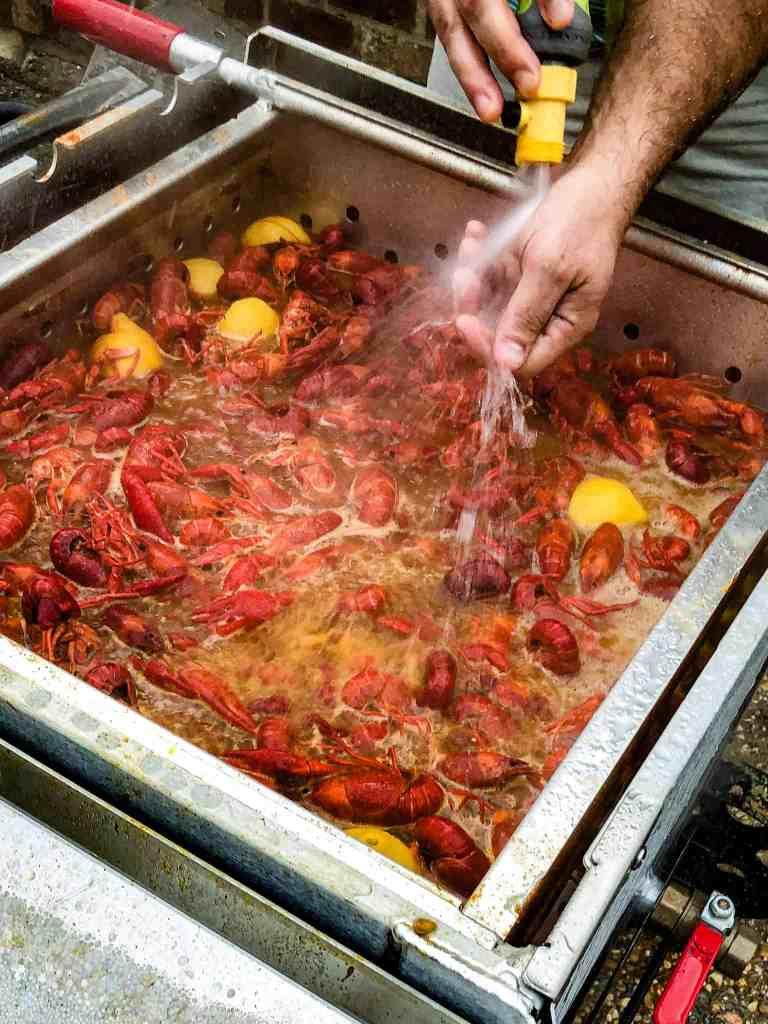 Spraying water over a boiled crawfish.
