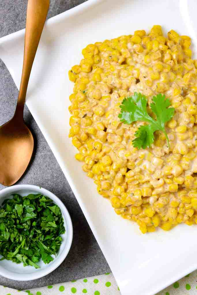 A bowl of Mexican Street Corn with cilantro.