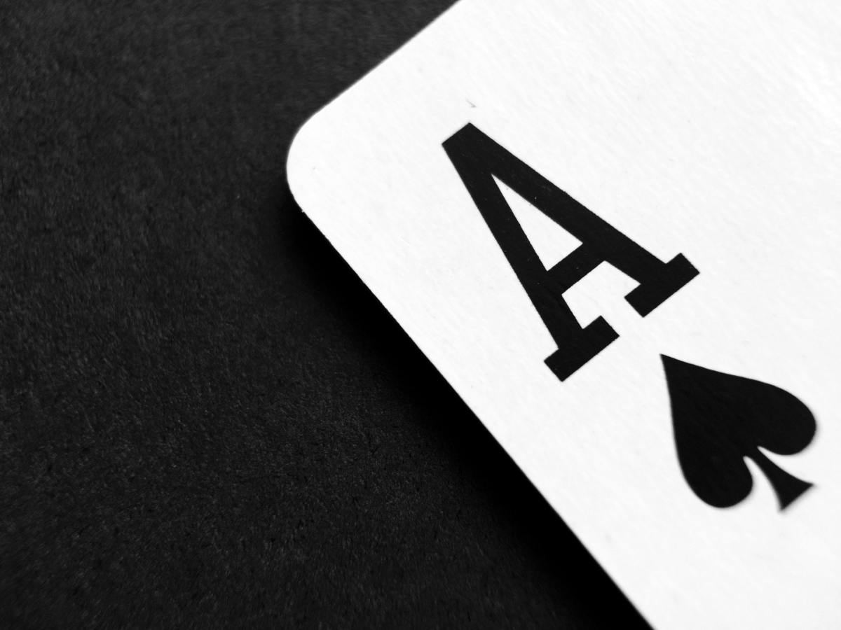 A playing card with the ace of spades