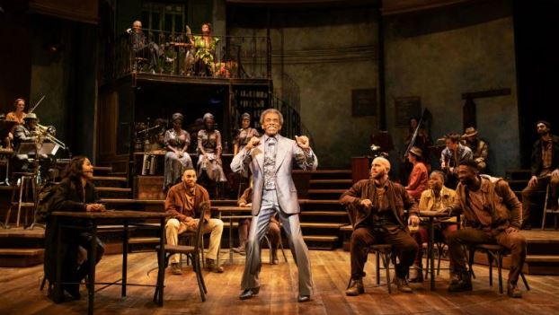 Andre De Shields and the company of Hadestown. Photo by Helen Maybanks.