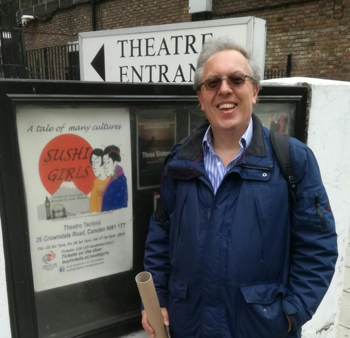 Playwright Tony Leliw outside the Theatro Technis with the poster for Sushi Girls