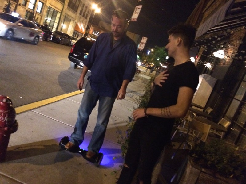 Learning how to ride a Hoverboard outside Soho Club
