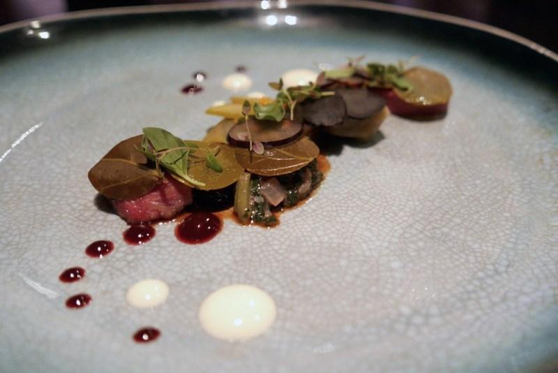 LAMB caper leaf, grapes,olives