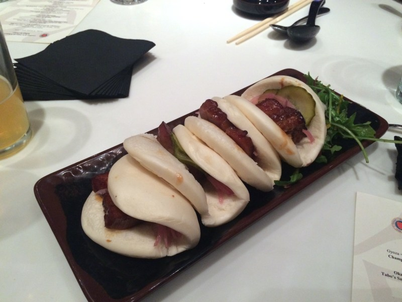 Pork Belly Bao with daikon-arugula salad, pickles