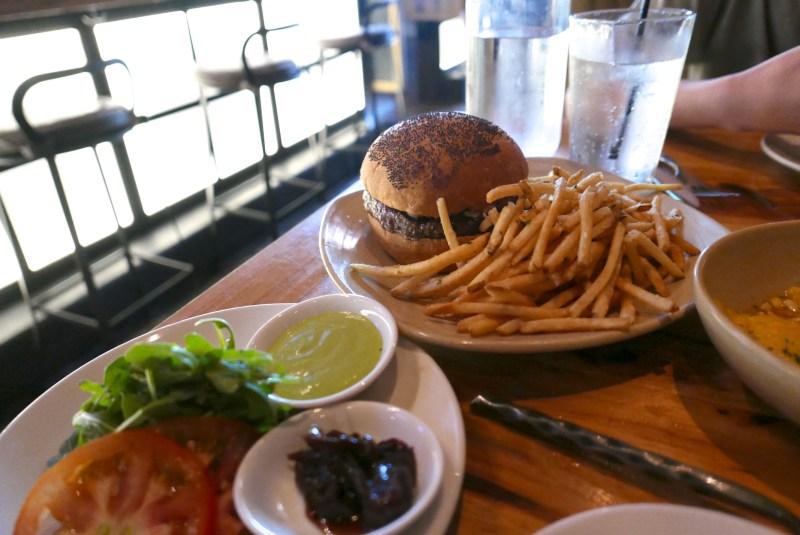 Angus Beef Burger, house pickles, balsamic onion, pesto aioli