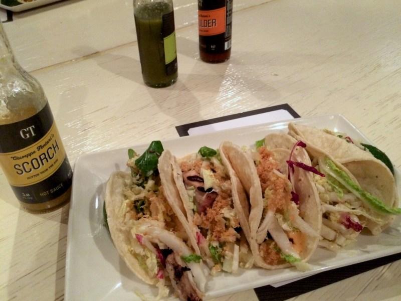 Fish tacos, garlic marinade, chipotle aioli, pork chicharron