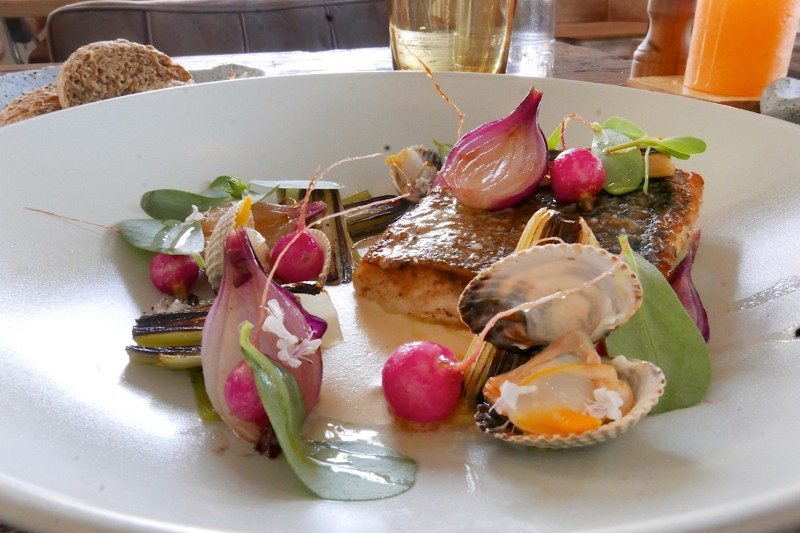 Sea bass, cockles, leeks, onion, radish