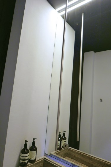 The hand faucet is suspended from the ceiling.