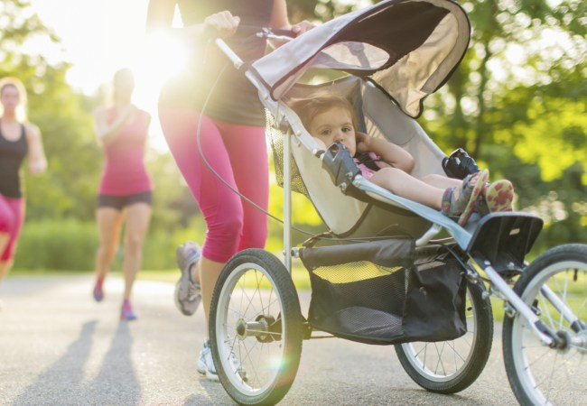 Woman jogging with stroller getting daily exercise