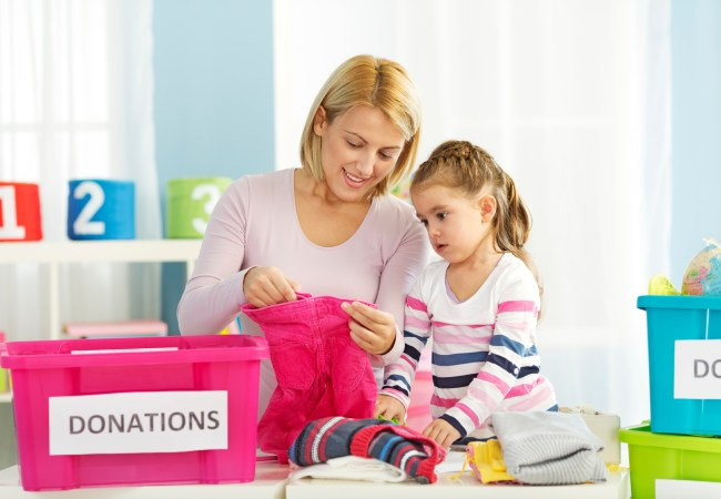 Mother and daughter sorting out donations for