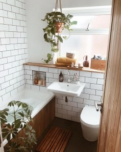 Inspiring Bathroom Decoration Ideas With Wooden Storage 19