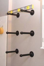 Innovative DIY Industrial Pipe Shelves You Can Make At Home 43