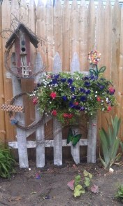 Beautiful Garden Fence Decorating Ideas To Follow 21