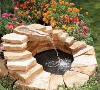 Innovative DIY Backyard Waterfall Ideas To Beautify Your Home Garden 08