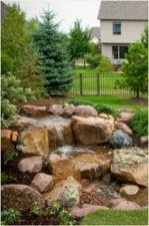 Innovative DIY Backyard Waterfall Ideas To Beautify Your Home Garden 13