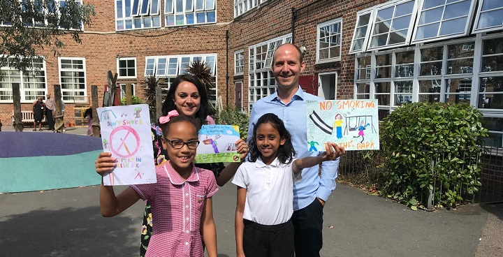 Cllr Davie with Martinet Ackerman, Jessop Assistant Headteacher, Skye and Divya holding their designs